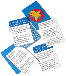 """A selection of cards from Cards for Calm: Kids, spread out on a white background.  The most prominent cards is """"Stand Up to Supervillains"""""""